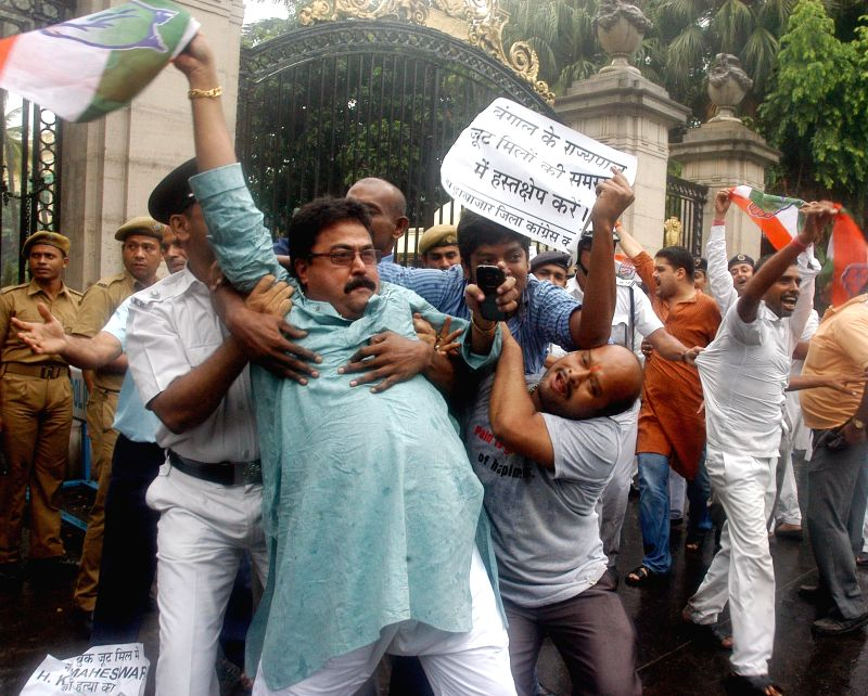 Congress workers demonstrate against West Bengal Government in front of Raj Bhawan in Kolkata on June 19, 2014.