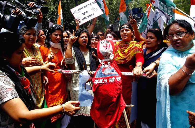 Congress workers demonstrate outside Bhartiya Janta Party (BJP) headquarters against Union Minister of State for Chemicals and Fertilisers, Nihal Chand Meghwal who was last week summoned by a ...