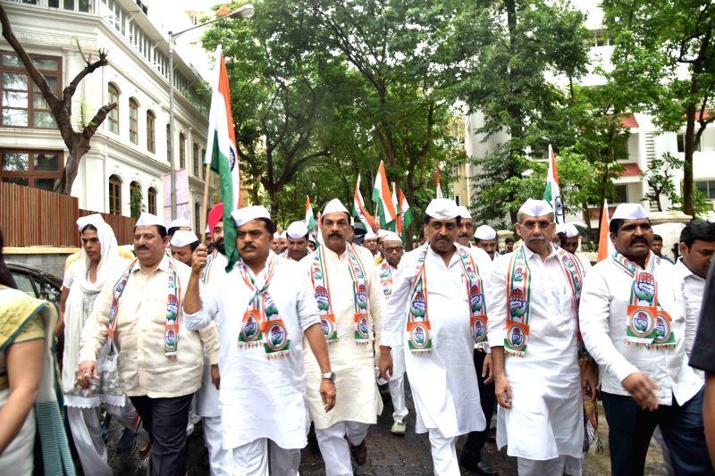 Congress workers led by Mumbai Congress chief Sanjay Nirupam participate in 'Tiranga Yatra' organised to mark the 76th anniversary of Quit India Movement, in Mumbai on Aug 9, 2018.