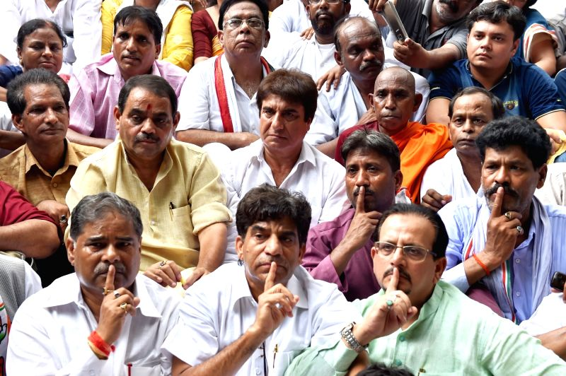Congress workers led by partys Uttar Pradesh president Raj Babbar stage a demonstration against Dalit Assault Case at Una; in Lucknow on July 21, 2016.