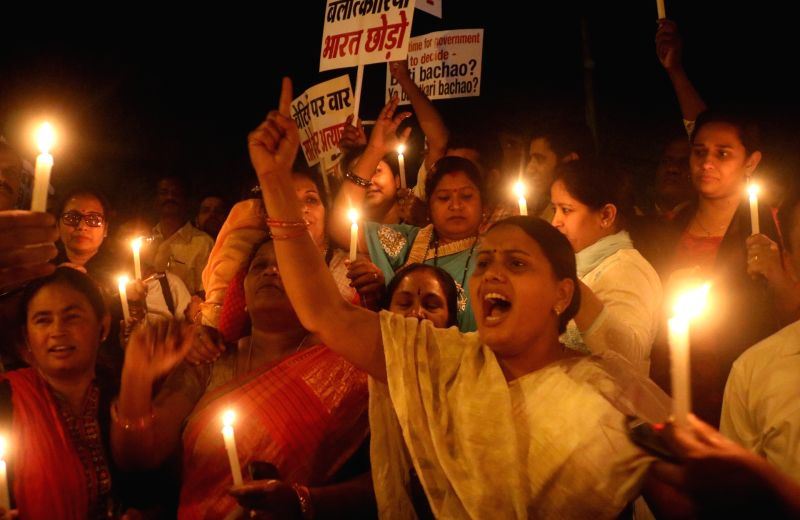 Congress workers participate in a candlelight vigil to to protest incidents of rape in Unnao (Uttar Pradesh) and Kathua (Jammu and Kashmir) at India Gate in New Delhi on April 12, 2018. ...