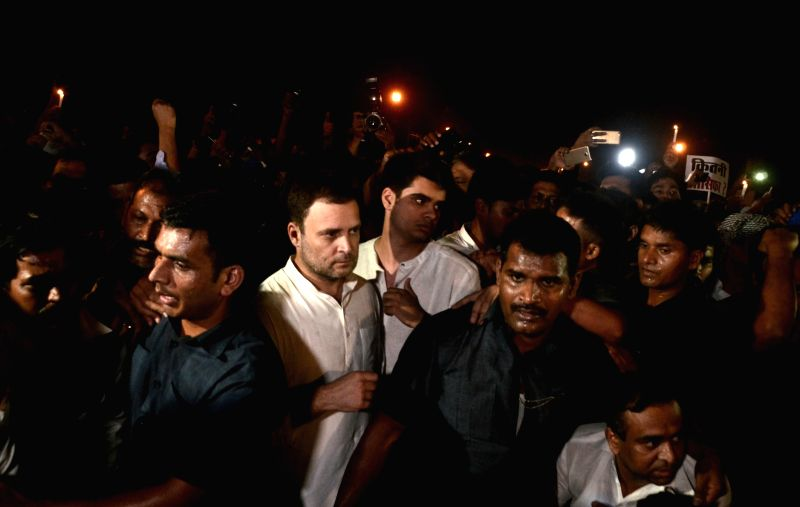 Congress workers participate in a candlelight vigil called by party president Rahul Gandhi to protest against incidents of rape in Unnao (Uttar Pradesh) and Kathua (Jammu and Kashmir) at ... - Rahul Gandhi