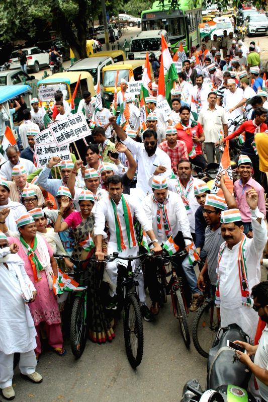 Congress workers participate in a cycle rally to press for employment for youth and to stage a demonstration against the Central and the state governments; in New Delhi on Aug 12, 2018.