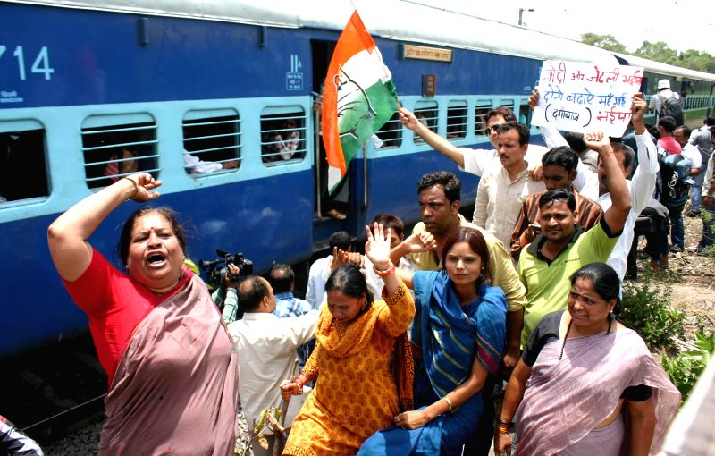 Congress workers participate in 'Rail Roko Andolan' organised to protest against rail tariff hike in Bhopal on June 22, 2014.