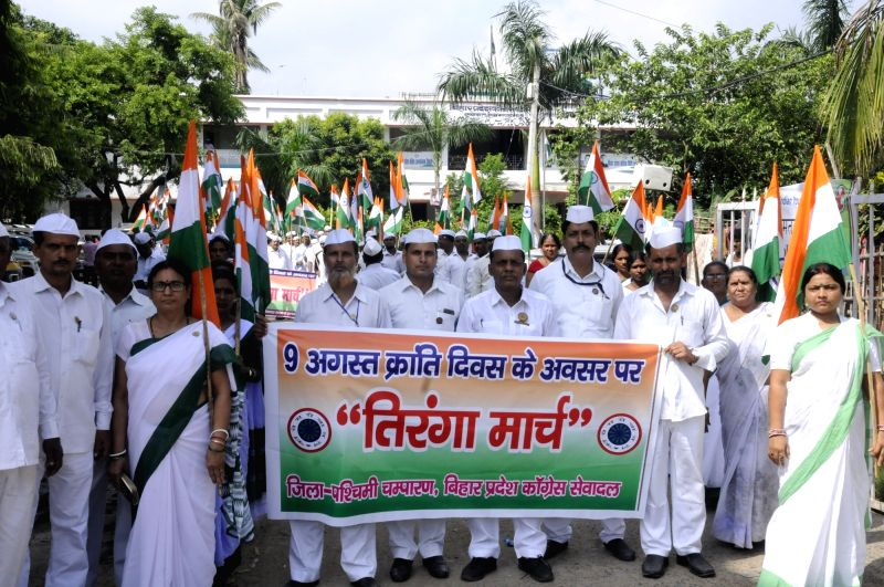 Congress workers participate in 'Tiranga Yatra' organised to mark the 76th anniversary of Quit India Movement, in Patna on Aug 9, 2018.