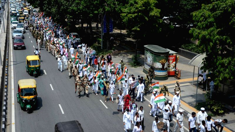 Congress workers participate in 'Tiranga Yatra' from Akbar road to Raj Ghat organised to mark the 76th anniversary of Quit India Movement in New Delhi on Aug 9, 2018.