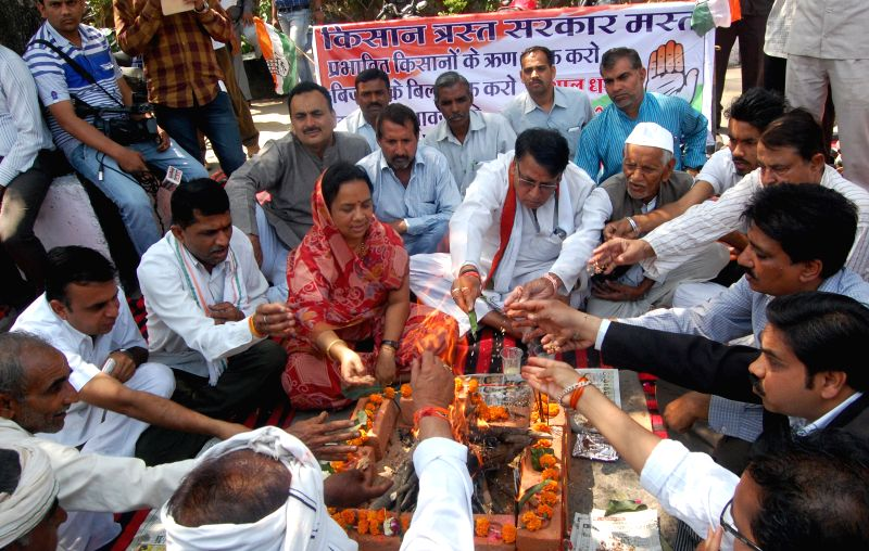 Congress workers perform `Sadbudhi Yagna`outside the Madhya Pradesh assembly in Bhopal, on March 27, 2015.