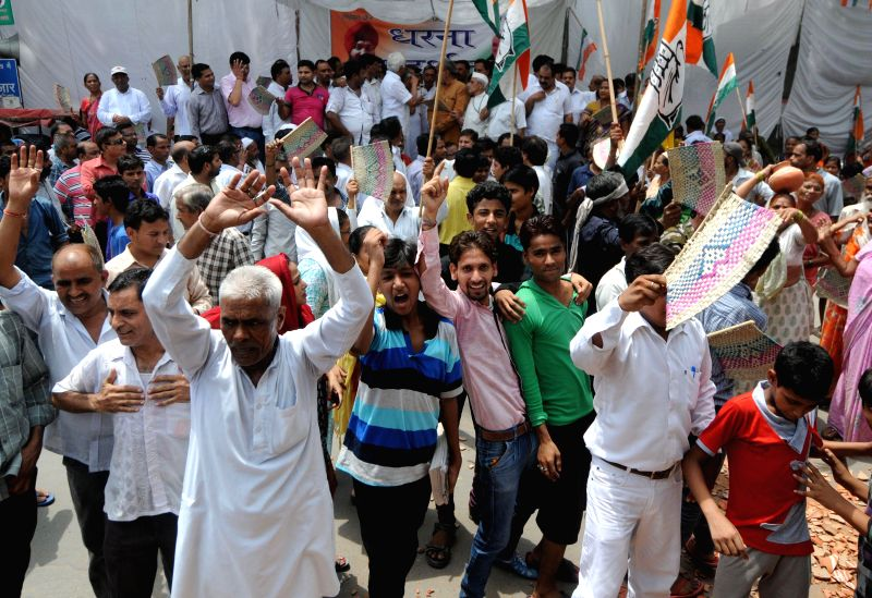 Congress workers protest against power cut in East Delhi on June 18, 2014.