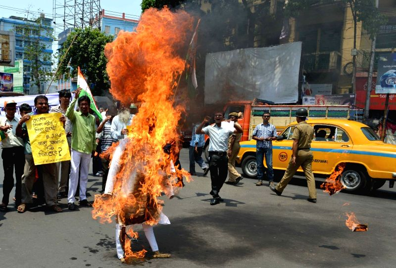 Congress workers stage a demonstration against BJP in Kolkata, on May 15, 2016.
