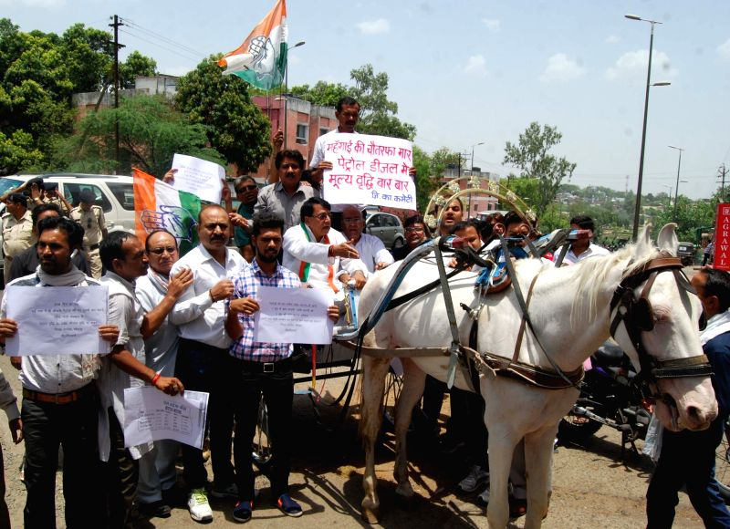 Congress workers stage a demonstration against hike in fuel prices in Bhopal, on June 1, 2016.