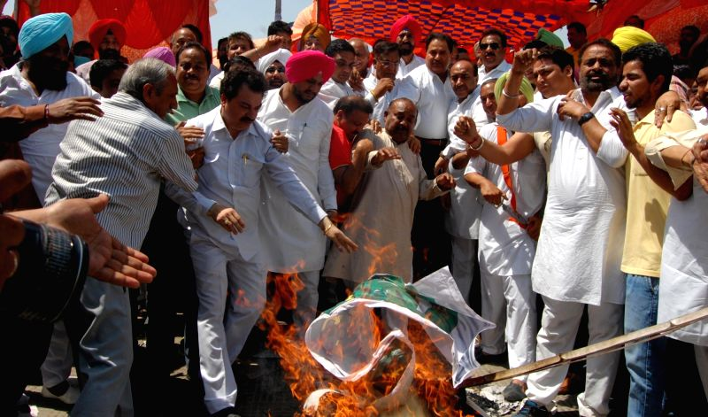 "Congress workers stage a demonstration against Pakistan Prime Minister Nawaz Sharif after an Army soldier and a BSF trooper were killed and ""mutilated"" on the LoC in Jammu and ... - Nawaz Sharif"