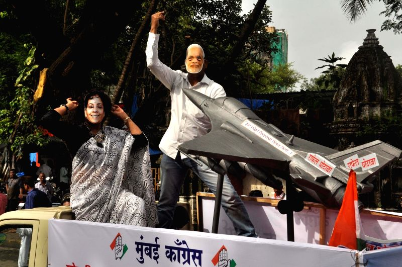 Congress workers stage a demonstration against the Central Government over Rafale deal in Mumbai on July 30, 2018.