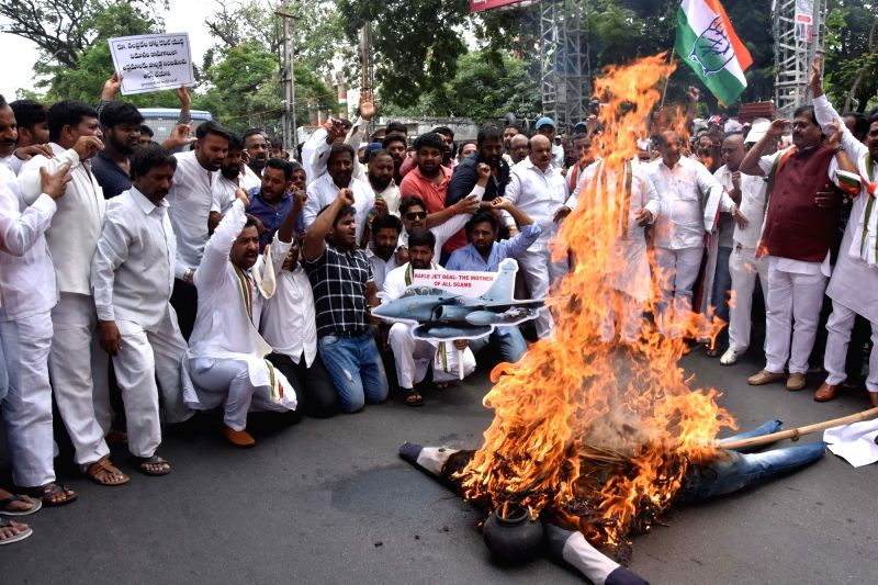 Congress workers stage a demonstration against the Narendra Modi led Central Government over the alleged corruption in the Rafale fighter jet deal; outside Gandhi Bhavan in Hyderabad on ... - Narendra Modi