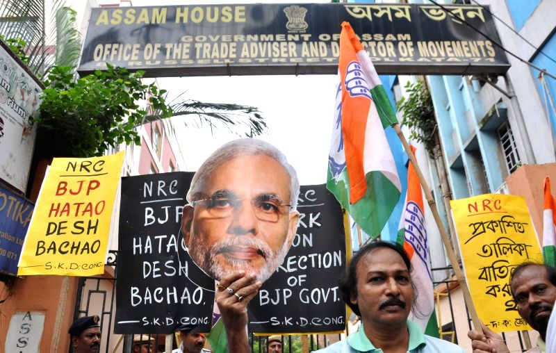 Congress workers stage a demonstration against the final draft of National Register of Citizens (NRC) of Assam that excludes over 40 lakh names; in Kolkata on Aug 2, 2018.