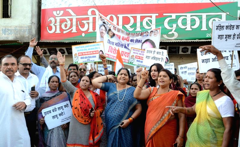 Congress workers stage a demonstration to press for shutting down liquor vends in residential areas of Bhopal on April 19, 2017.