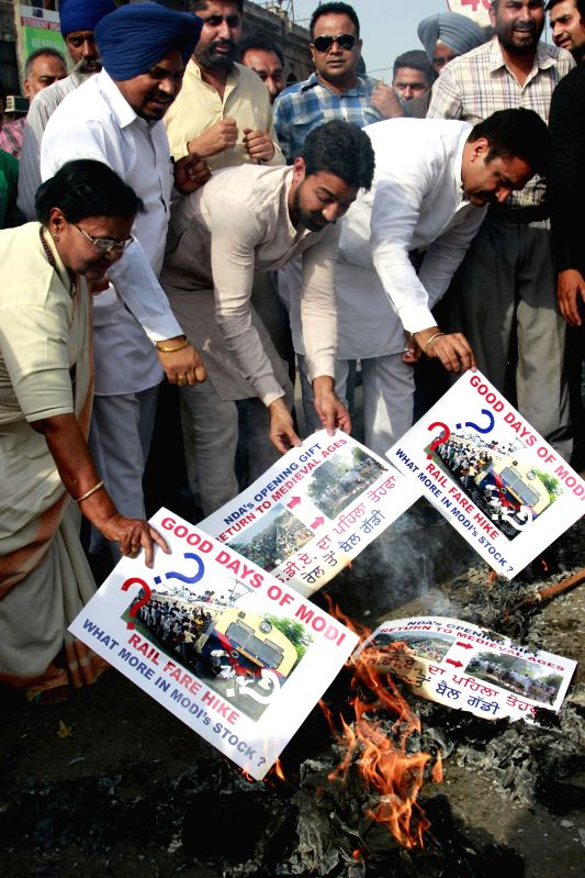 Congress workers staging a protest against proposed rail fare hike in Amritsar on June 21, 2014.