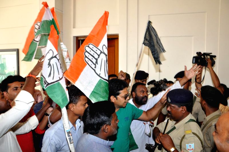 Congress workers waving black flags and shouting anti Jairam Ramesh slogans outside the venue of `Chintan Meeting` being held by Pradesh Congress Committee in Ranchi on June 17, 2014.