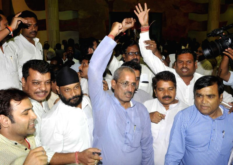 Congressmen led by leader of opposition in Madhya Pradesh Legislative Assembly and Congress leader Satyadev Katare demonstrate against Vyapam scam in Bhopal on July 2, 2014.