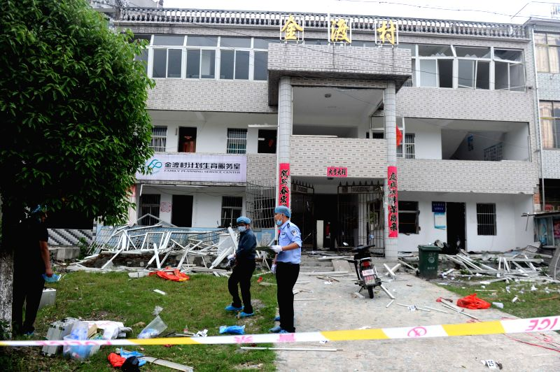Policemen investigate at the accident site of a blast in Jindu village of Congyang county, east China's Anhui Province, May 16, 2014. Two people were killed and ...
