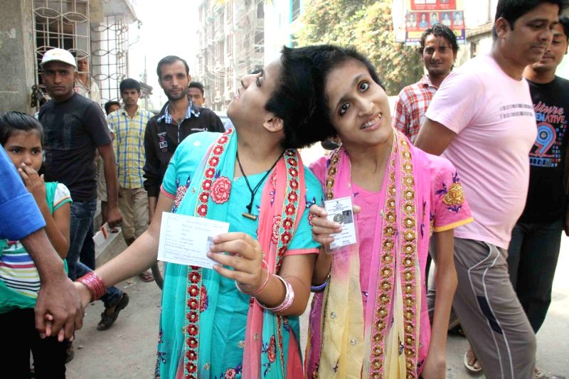 Conjoined twins Saba and Farah arrive to cast their vote during the third phase of Bihar assembly polls in Patna on Oct 28, 2015.