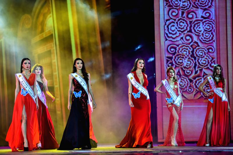 Contestants compete in the evening dress session during the final of the 27th Miss Model of the World (MMW) Contest in Shenzhen, south China's Guangdong Province, ...