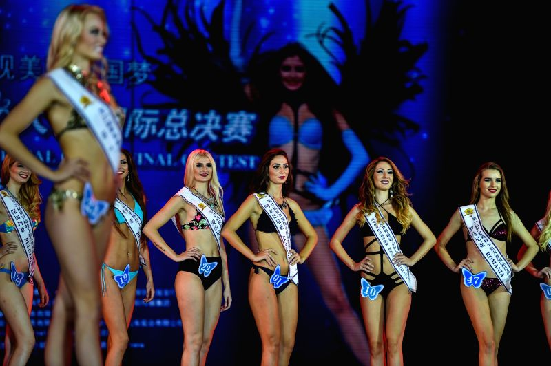 Contestants compete in the swimwear session during the final of the 27th Miss Model of the World (MMW) Contest in Shenzhen, south China's Guangdong Province, Oct. ...