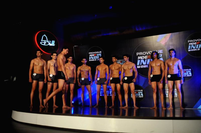 Contestants walk on the ramp during the Provogue Mr India 2014 finale in Mumbai, on May 8, 2014.