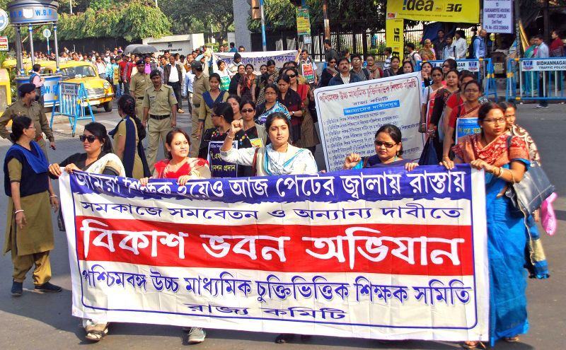 Contractual teachers participate in a protest rally against West Bengal Education Department at Salt Lake in Kolkata on Jan 5, 2014.
