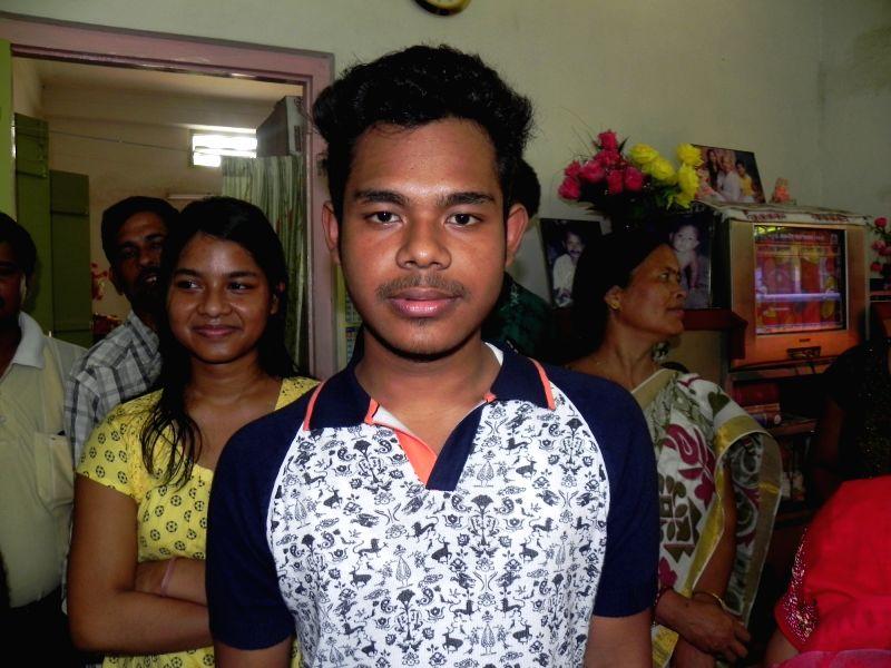 Cooch Behar: West Bengal Board of Secondary Education (WBBSE) topper Shouvik Barman in Cooch Behar on May 10, 2016.