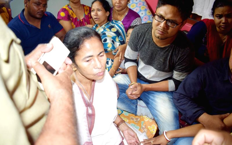 Cooch Behar: West Bengal Chief Minister Mamata Banerjee meets the family members of CRPF personnel Krishna Kumar Das who attained martyrdom in a maoist attack in Sukma of Chhatisgarh on 24th April ... - Mamata Banerjee and Kumar Das