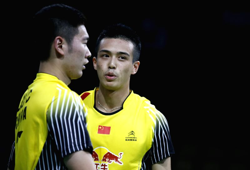 Kang Jun (R) and Liu Cheng of China react during their Men's Doubles Round 1 match  against Takeshi Kamura and Keigo Sonoda of Japan on Day 1 of Li Ning BWF ...