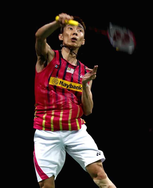 Lee Chong Wei of Malaysia returns the shuttle during the Men's Singles Round 1 match against Lee Dong Keun of South Korea on Day 1 of Li Ning BWF World ...