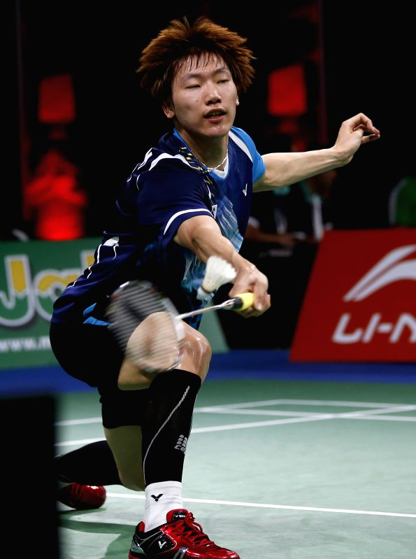Lee Dong Keun of South Korea reacts during the Men's Singles Round 1 match against Lee Chong Wei of Malaysia on Day 1 of Li Ning BWF World Championships 2014 at