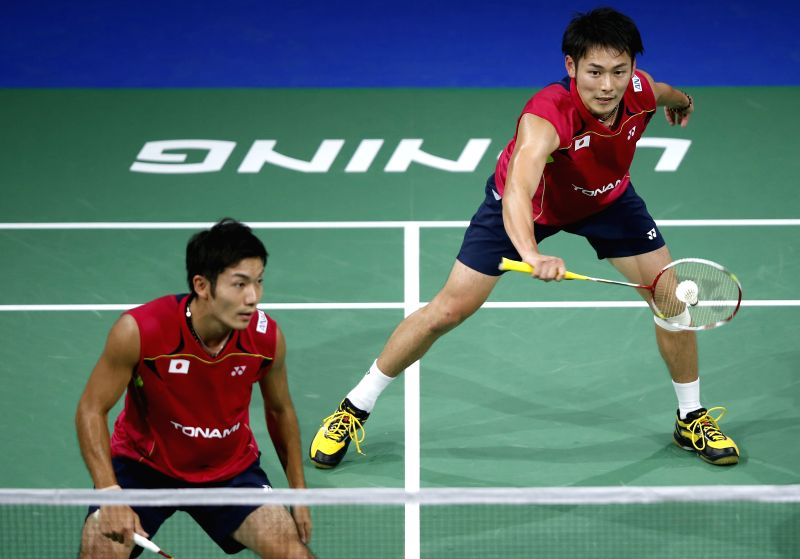Takeshi Kamura (R) and Keigo Sonoda of Japan return the shuttle against Kang Jun and Liu Cheng of China during their Men's Doubles Round 1 match on Day 1 of Li ..