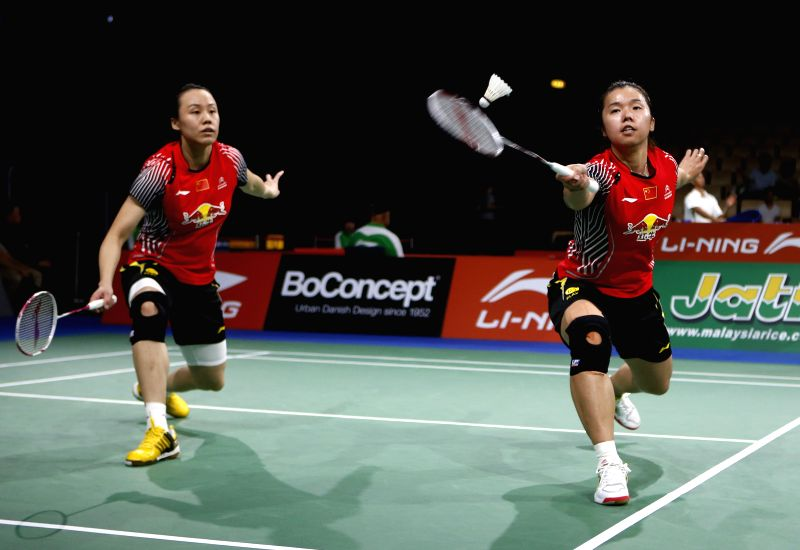 Tian Qing(R) and Zhao Yunlei of China return the shuttle during the Women's Doubles Round 2 match against Jwala Gutta and Ashwini Ponnappa of India on Day 3 of Li