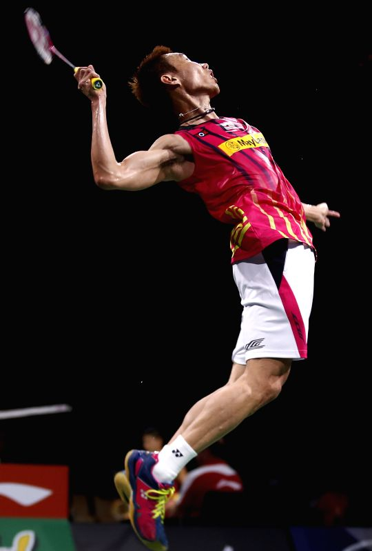 Chong Wei Lee of Malaysia returns the shuttle during the Men's Singles Round 2 match against Dieter Domke of Germany on Day 3 of Li Ning BWF World Championships .