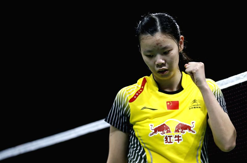 Li Xuerui celebrates during the Women's Singles Quarter Finals match against Saina Nehwal of India on Day 5 of Li Ning BWF World Championships 2014 at Ballerup ...