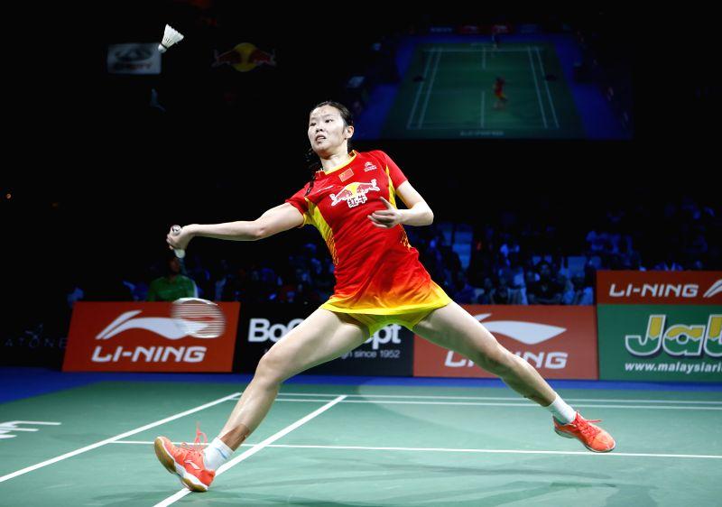Li Xuerui of China returns the shuttle during the Women's Singles Semifinal against Minatsu Mitani of Japan on Day 6 of Li Ning BWF World Championships 2014 at ...