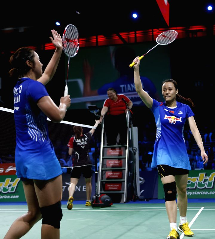 Tian Qing and Zhao Yunlei(R) of China greet the spectators after the Women's Doubles Semifinal match against Lee So Hee and Shin Seung Chan of South Korea on Day .