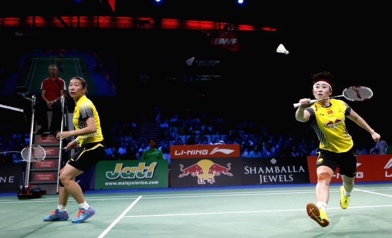 Wang Xiaoli and Yu Yang(R) of China return the shuttle during the Women's Doubles Semifinal against Reika Kakiiwa and Miyuki Maeda of Japan on Day 6 of Li Ning ...