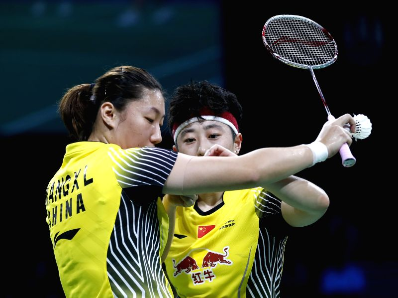 Yu Yang(R) of China helps her partner Wang Xiaoli tidy up the medical bandage during the Women's Doubles Semifinal against Reika Kakiiwa and Miyuki Maeda of Japan