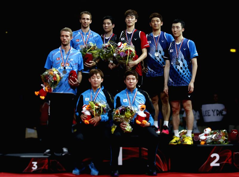 Ko Sung Hyun (3rd,L,Back) and Shin Baek Choel (3rd,R,Back) of South Korea celebrate during the awarding ceremony for the Men's Doubles Finalon Day 7 of Li Ning ...