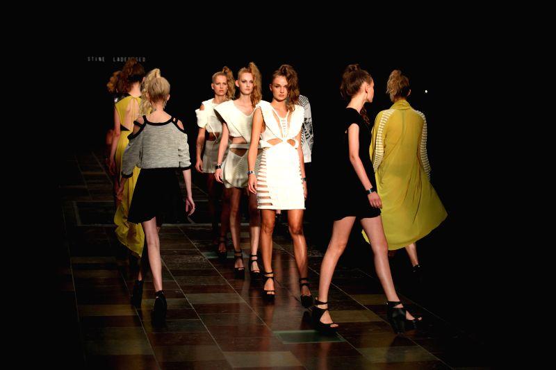Models present creations by Denmark's designer Stine Ladefoged during Copenhagen Fashion Week, in Copenhagen, Denmark, Aug. 7, 2014.