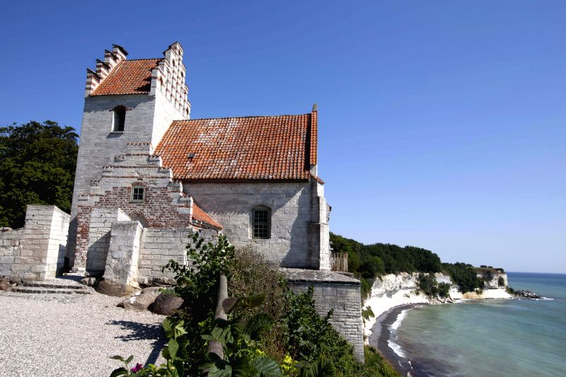 Photo  taken on July 10, 2014 shows an old church on Stevns Klint in southern Seeland of Denmark. The geological site Stevns Klint comprises a 15 km-long ...