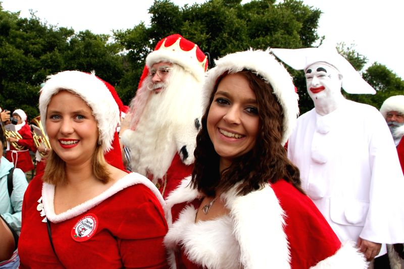 COPENHAGEN, July 23, 2018 - People dressed as Santa Claus gather in Copenhagen, capital of Denmark, on July 23, 2018. The 2018 World Santa Claus Congress kicked off at Bakken amusement park, north of ...