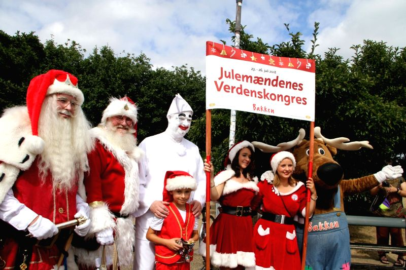 COPENHAGEN, July 23, 2018 - People dressed as Santa Claus pose for photos in Copenhagen, capital of Denmark, on July 23, 2018. The 2018 World Santa Claus Congress kicked off at Bakken amusement park, ...