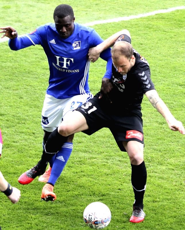 COPENHAGEN, May 8, 2017 - Sonderjyske's Matthias Maak (R) vies with Lyngby's Kim Ojo during Danish Superliga Championship Group Round 6 match between Lyngby and Sonderjyske at Lyngby Stadium in ...