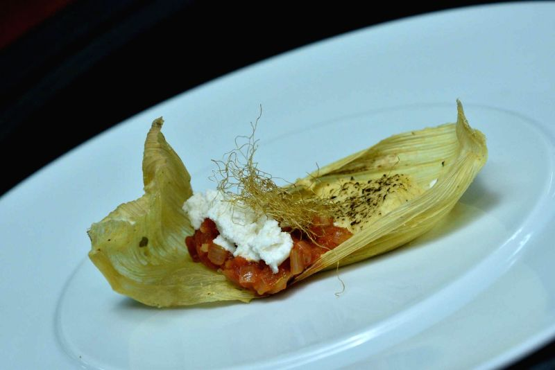 Corn Envuelto (Corn wrap with Corn Served With Hogao Sauce And Fresh Cheese.