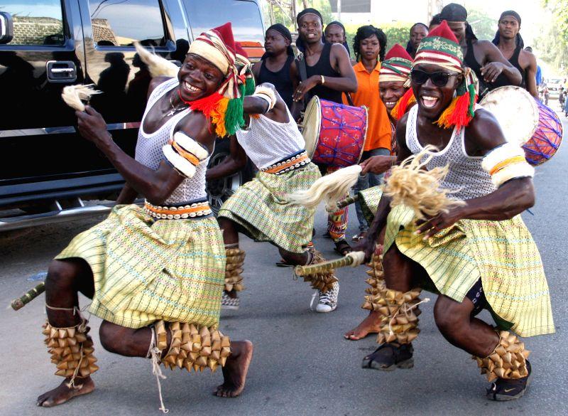Dancers participate in the annual Benin Dancing Carnival in Cotonou, capital of Benin, on April 29, 2014.