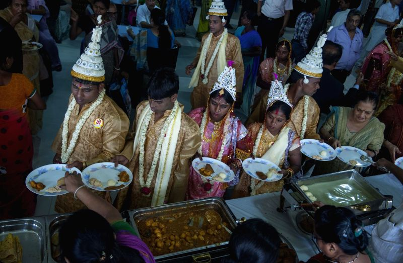 Couples during a mass marriage programme organised by Vishwa Jagriti Mission Trust in Kolkata on June 18, 2014.